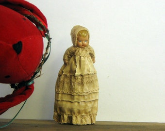 Ike & Sandy Spillman Christening Baby Ornament, part of RED RABBIT collection