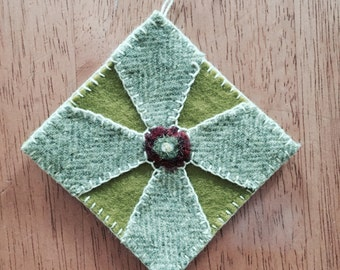 Christmas Ornament Done With Light Green Wool Fabric On Green Felt