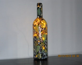 Wine bottle with yellow Daisies hand painted with lights