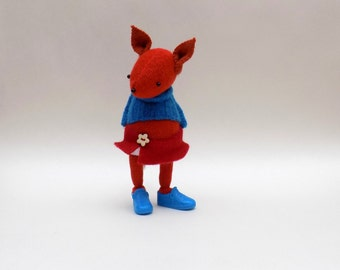 Woollen Fox  -  Handmade woolly plush fox wearing blue woollen pullover, white felt pants and a red felt skirt.