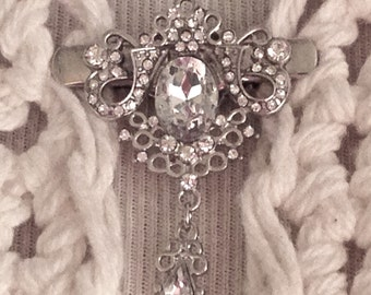 The mattie silver tone and rhinestone drop sweater clip brooch