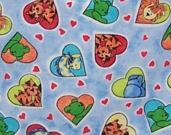 Burp Cloth Animal Friends features a blue background with colorful hearts, each framing animals: lions, tigers, giraffes, bears, BC002