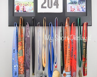 Black Sport Medal display with clamp bib holder and photo frames. Black mat.