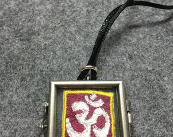 OM necklace in locket, embroidered symbol