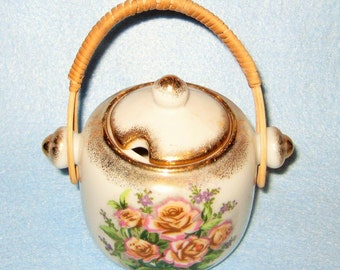 Vintage Sugar Bowl with Rattan Handle with glided floral design.