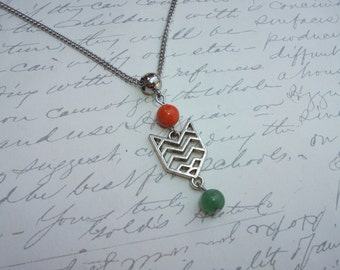 Chevron design arrow necklace with green and orange stones