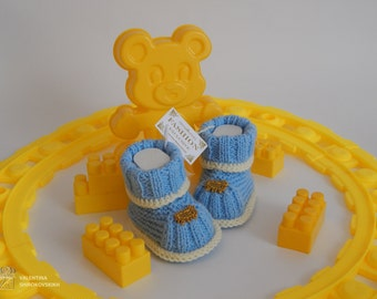 Beautiful knitted booties for the baby.