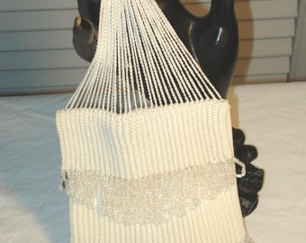 Last chance price! 1920s flapper beaded bag in white crochet with clear beaded trim.  Excellent condition.