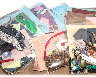 Joblot of craft packs x 12 beads,card,fabric die cuts,ribbons,findings,papers