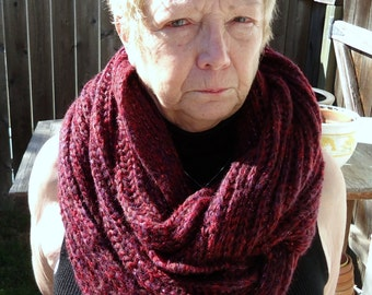 Knitted Cowl in shades of red.