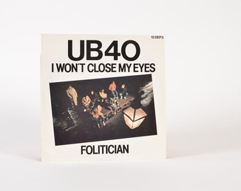 "UB40 - ""I Won't Close My Eyes / Folitician"" vinyl record"