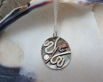 Small Oval Pendant in sterling silver oxidized with copper