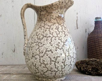 Antique brown transferware pitcher with bumble bee pattern