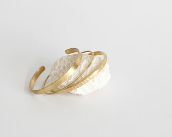 Set of 3 different brass cuff bracelets: 1 large one with brushed finish, +1 delicate thin one +1 with hammered finish