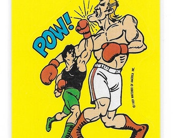 1989 Nintendo Topps Mike Tyson's Punch-Out Sticker Card Little Mac Knocking out Glass Joe