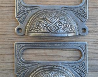 A pair of large Edwardian cast iron label frame handles CB10