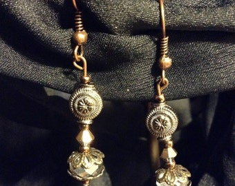 Antique brass and silver dangle earrings with unique detail!