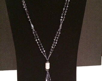 Black Beaded Knotted Necklace with Crystal Center.