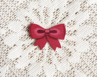 Red bow pin [hand drawn]