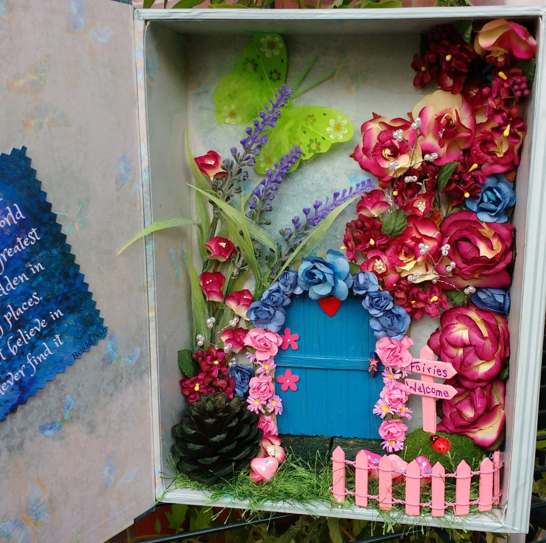 Fairy garden within a book box secret fairy door secret for Secret fairy doors by blingderella