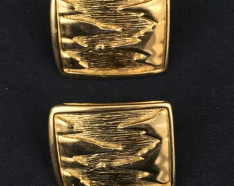 VIntage goldtone clip on earrings. Goldtone with relief mountain design signed BG