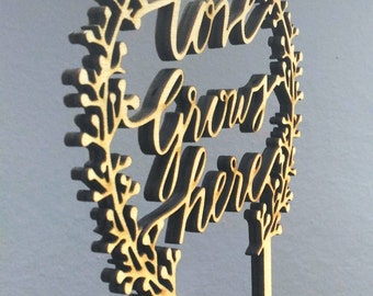 Love grows here wooden laser cut cake topper