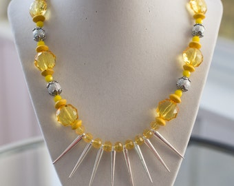 make a statement with this yellow and silver spiked set