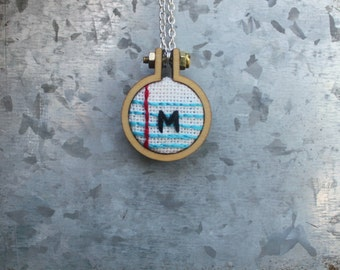 Embroidered notebook paper necklace
