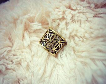 Climber Flower Seed of Life in brass metal. Sacred geometry. Merkaba.
