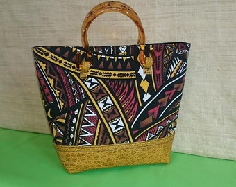 """Tote-Tribal print with acrylic handles. Leather animal print bottom cap. Made with """"Aloha"""" in Hawaii."""