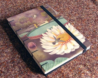 Coptic binding blank notebook with illustrated cover