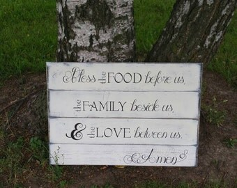 Bless the food before us, the family beside us, and the love between us. Wood sign