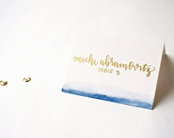 watercolor navy ombré handwritten escort cards // place card calligraphy in gold and silver pen // watercolor wedding stationery