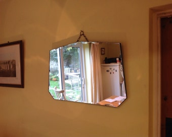 A stunning large vintage Art Deco wall mirror with scalloped bevelled edges. 1930's/40's