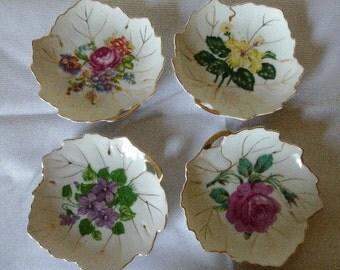 Set of four Nasco china leaf plates
