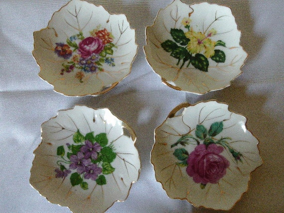 Set of four Nasco china leaf plates