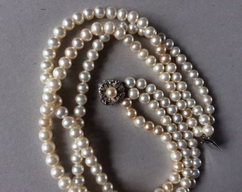 silver catch,three row c1930s 1/4 inch faux  pearl beads. 16 inches long.