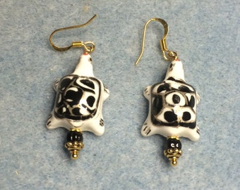 Black and white porcelain turtle bead dangle earrings adorned with black Czech glass beads.