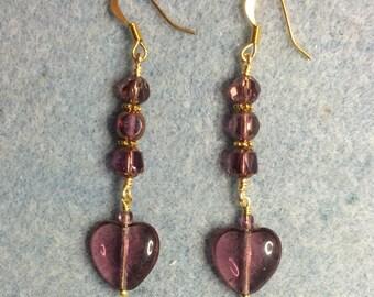 Transparent violet Czech glass heart bead dangle earrings adorned with violet Czech glass beads.