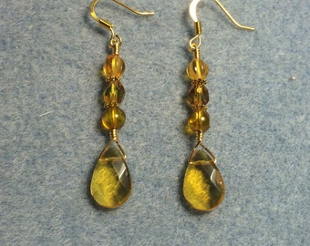 Topaz briolette dangle earrings adorned with topaz Czech glass beads.