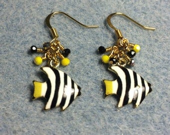 Black, yellow and white striped enamel fish charm earrings adorned with tiny black and yellow Chinese crystal beads.