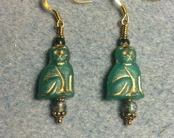 Emerald green Czech glass cat bead dangle earrings adorned with emerald green Czech glass beads.