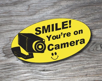 "5""x2.5"" Vinyl Sticker {Smile You're On Camera!}"
