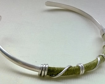 Silver bangle with variegated cotton and wire wrap detail