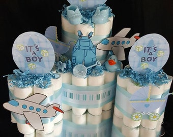 It's a Boy 2 tier Diaper Cake includes 3 mini cakes Great Door Prizes or keepsakes Airplane stroller coveralls/Centerpiece/ Shower favors