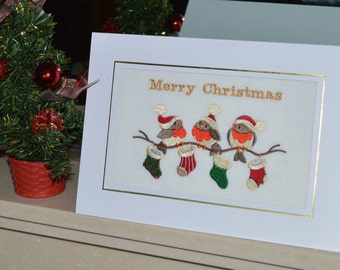 A Large machine embroidered hand finished christmas card - Robin On Branch With Christmas Stockings.