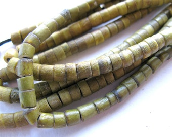 Shell heishi, green shell, 30 inch strand, 4mm - 476