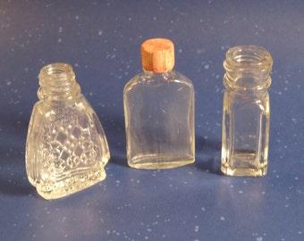 Three Small Glass Bottles