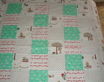 Modern handmade baby girl quilt featuring fabrics by Riley Blake