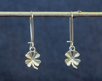Vintage earrings with silver four-leaf clover